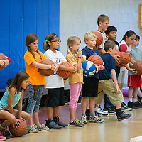 060613       Brian Leddy<br /> Kids participating in the Rehoboth Basketball Camp listen to instructions Thursday at the school. The camp was for third to fifth-graders.
