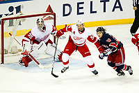 March 09, 2014: Detroit Red Wings Defenceman Niklas Kronwall (55) 2193 shoves New York Rangers Right Wing Mats Zuccarello (36) 7214 in front of the Red Wings net during a regular season NHL Eishockey Herren USA game between the Detroit Red Wings and the New York Rangers at Madison Square Garden in New York, NY. New York Rangers goalie Henrik Lundqvist collects his 49th career shut out which ties the franchise record as the Blueshirts defeat the Red Wings 3-0. NHL Eishockey Herren USA MAR 09 Red Wings at Rangers <br /> Norway only