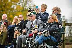 Veterans, service personnel and families look on during the first ever memorial service dedicated to horses killed or injured in conflict, at the Royal Navy and Royal Marines Riding Stables at Bickleigh Barracks, Plymouth.