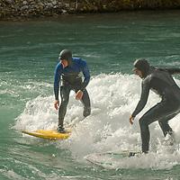 River wave surfing on Kananaskis River, Kananskis Provincial Park, near Banff and Calgary, Alberta, Canada