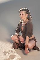 Sexy deva poised in the sand.