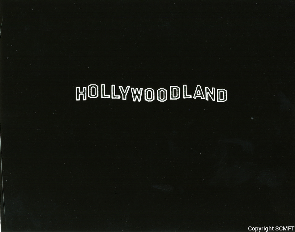 1928 Hollywoodland sign at night, first lit on Dec. 8, 1923, shortly after the sign was completed.
