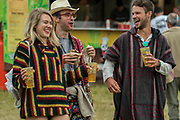 Enjoying a drink in the Arena - The 2017 Latitude Festival, Henham Park. Suffolk 15 July 2017