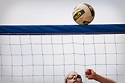 Joe Snyder of Coeur d'Alene stares up at a volleyball hovering on the net during the beach volleyball tournament at North Idaho College beach on Saturday.
