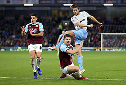 West Ham United's Andy Carroll (right) under pressure from Burnley during the Premier League match at Turf Moor, Burnley.