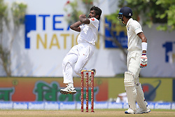 July 27, 2017 - Galle, Sri Lanka - Sri Lankan cricketer Nuwan Pradeep(L) leaps in the air while delivering a ball during the 2nd Day's play in the 1st Test match between Sri Lanka and India at the Galle International cricket stadium, Galle, Sri Lanka on Thursday 27 July 2017  (Credit Image: © Tharaka Basnayaka/NurPhoto via ZUMA Press)