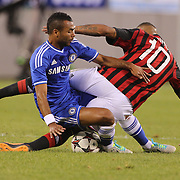 Ashley Cole, Chelsea, (left) tackles Kevin-Prince Boateng, AC Milan, during the Chelsea V AC Milan Guinness International Champions Cup tie at MetLife Stadium, East Rutherford, New Jersey, USA.  4th August 2013. Photo Tim Clayton