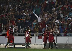 October 10, 2017 - Lisbon, Portugal - Portugal players celebrating their goal scored by Portugal's midfielder Joao Mario (R) during the FIFA 2018 World Cup Qualifier match between Portugal and Switzerland at the Luz Stadium on October 10, 2017 in Lisbon, Portugal. (Credit Image: © Carlos Costa/NurPhoto via ZUMA Press)