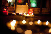 """With God, Vaclav"" is written on a paper in between candles. Havel was a Czech playwright, essayist, poet, dissident and politician. After the announcement of his death spontaneously thousands of people People are meeting on ""Narodni"" street at the ""Velvet Revolution Memorial"" and other places in Prague to commemorate the death of former Czech President Vaclav Havel with flowers and candles."