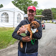 Peter Gray with Sue Ockendon's new puppy arrive at the MARS Incorporated Bromont CCI Three Day Event in Bromont, Quebec.