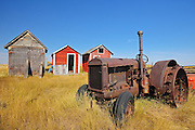Old tractor and sheds<br /> Fusilier<br /> Saskatchewan<br /> Canada