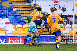 James Perch of Mansfield Town heads with ball out of the area - Mandatory by-line: Ryan Crockett/JMP - 20/02/2021 - FOOTBALL - One Call Stadium - Mansfield, England - Mansfield Town v Cambridge United - Sky Bet League Two