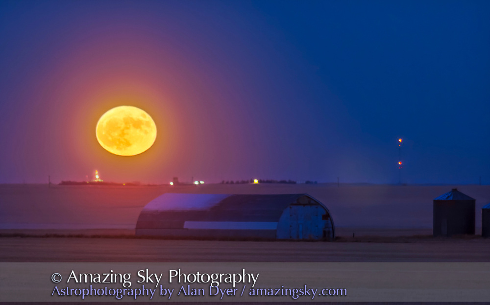 """The Full Moon and a perigean Full Moon at that, rising near home over a prairie farm in the distance, on December 3, 2017. <br /> <br /> This was another much-publicized """"supermoon."""" <br /> <br /> I shot this with the Canon 60Da and 200mm lens and 1.4x Convertor. It is a stack of 4 exposures blended with Luminosity masks, as no one exposure can capture the dark ground and bright Moon together."""