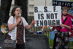 Tanya Murat of Southwark Defend Council Housing addresses leaseholders and tenants living in unsafe homes during a protest opposite Downing Street on 15th July 2021 in London, United Kingdom. Some leaseholders are faced with crippling costs to fix safety issues and they called on the government to ensure that their homes are made safe from fire as a matter of priority, to make interim payments and to cover fire safety remediation costs and to find a solution with mortgage lenders which enables them to move on with their lives. Speakers also called for justice for the survivors and victims of the Grenfell fire.