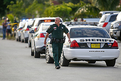 March 2, 2018 - West Palm Beach, Florida, U.S. - A PBSO deputy is seen at the 1100 block of Hiawatha Avenue in West Palm Beach, Fla., on Friday, March 2, 2018. A Friday afternoon shooting on Hiawatha Avenue shooting left two people dead and one injured, according to PBSO. (Credit Image: © Andres Leiva/The Palm Beach Post via ZUMA Wire)
