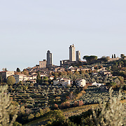 SAN GIMIGNANO, ITALY - OCTOBER 25: San Gimignano is an Italian hill town in Tuscany, southwest of Florence. Encircled by 13th-century walls, its old town centers on Piazza della Cisterna, a triangular square lined with medieval houses. It has a skyline of medieval towers, including the stone Torre Grossa. San Gimignano, Tuscany, Italy. 25th October 2017. Photo by Tim Clayton/Corbis via Getty Images)