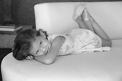 little girl on a couch