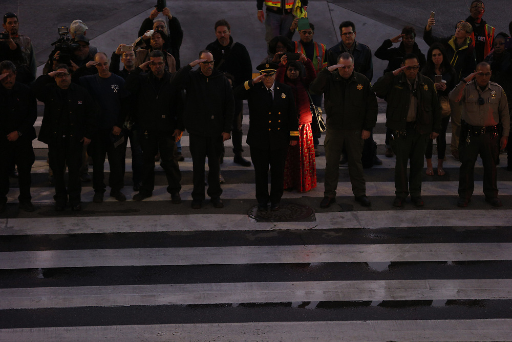 San Francisco Fire Department Chief Joanne Hayes-White (center), firefighters and and sheriff's department officials salute as the casket of San Francisco Mayor Ed Lee is carried into City Hall on Friday, Dec. 15, 2017, in San Francisco, Calif. Mayor Ed Lee was lain in state at the rotunda of City Hall. Lee died on Tuesday from a heart attack. He was 65 years old.