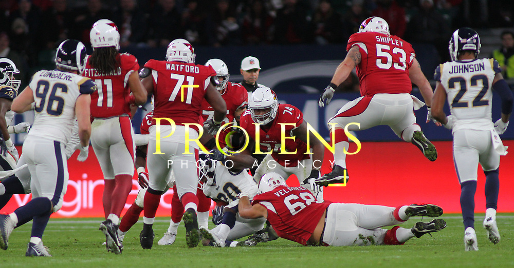 LONDON, ENGLAND - OCTOBER 22: Los Angeles Rams free safety Lamarcus Joyner (20) is tackled as Arizona Cardinals center A.Q. Shipley (53) leaps over a team mate during the NFL match between the Arizona Cardinals and the Los Angeles Rams at Twickenham Stadium on October 22, 2017 in London, United Kingdom. (Photo by Mitchell Gunn/ESPA-Images) *** Local Caption ***