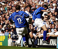 Copyright Sportsbeat. 0208 3926656<br />Picture: Henry Browne<br />Date: 05/04/2003<br />Tottenham Hotspur v Birmingham City FA Barclaycard Premiership<br />Teddy Sheringham of Spurs is hounded out by Jeff Kenna and Kenny Cunningham of City