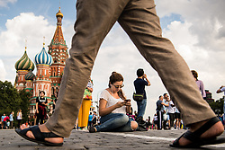 July 13, 2018 - Moscow, Russia - 180713 A women is seen siting on the ground in front of The Saint Basil's Cathedral at the Red Square during the FIFA World Cup on July 13, 2018 in Moscow..Photo: Petter Arvidson / BILDBYRN / kod PA / 92086 (Credit Image: © Petter Arvidson/Bildbyran via ZUMA Press)