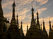 Spires at sunset at the Shwedagon Pagoda complex, in the center of Yangon (Rangoon), It is the most sacred Buddhist Stupa in Myanmar and one of the most important religious reliquary monuments in the world