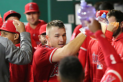 April 12, 2018 - Kansas City, MO, U.S. - KANSAS Kansas City, MO - APRIL 12: Los Angeles Angels center fielder Mike Trout (27) in the dugout after hitting a solo home run in the eighth inning of an MLB game between the Los Angeles Angels of Anaheim and Kansas City Royals on April 12, 2018 at Kauffman Stadium in Kansas City, MO. The Angels won 7-1. (Photo by Scott Winters/Icon Sportswire) (Credit Image: © Scott Winters/Icon SMI via ZUMA Press)