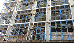 KABUL, Sept. 7, 2016 (Xinhua) -- People stand inside a destroyed business center one day after a terrorist attack in Kabul, capital of Afghanistan, Sept. 7, 2016. Terrorist attack on the aid agency CARE International in downtown Kabul on Monday night that ended Tuesday morning had either destroyed or badly damaged several residential houses, shopping malls and a business center and nearly inflicted millions of U.S. dollars loses to the people. (Xinhua/Jawid Omid).****Authorized by ytfs* (Credit Image: © Jawid Omid/Xinhua via ZUMA Wire)