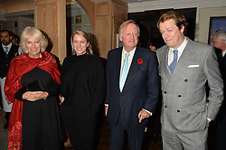 Left to right, The DUCHESS OF CORNWALL, LAURA LOPES, ANDREW PARKER BOWLES and TOM PARKER BOWLES at a party hosted by Ewan Venters CEO of Fortnum & Mason to celebrate the launch of The Cook Book by Tom Parker Bowles held at Fortnum & Mason, 181 Piccadilly, London on 18th October 2016.