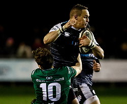 Hanno Dirksen of Ospreys is tackled by Jack Carty of Connacht<br /> <br /> Photographer Simon King/Replay Images<br /> <br /> Guinness PRO14 Round 7 - Ospreys v Connacht - Friday 26th October 2018 - The Brewery Field - Bridgend<br /> <br /> World Copyright © Replay Images . All rights reserved. info@replayimages.co.uk - http://replayimages.co.uk