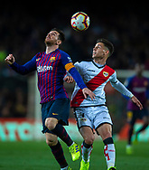 Leo Messi of Barcelona (left) controls in the air the ball in front of Alex Moreno (right) of Rayo Vallecano during the Spanish league football match of 'La Liga'  FC BARCELONA against RAYO VALLECANO at Camp Nou Stadium of Barcelona on March 9,2019