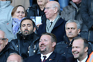 Jose Mourinho, the Manchester Utd manager (r) looks on as he sits in the stands after his touchline ban. Premier league match, Swansea city v Manchester Utd at the Liberty Stadium in Swansea, South Wales on Sunday 6th November 2016.<br /> pic by  Andrew Orchard, Andrew Orchard sports photography.