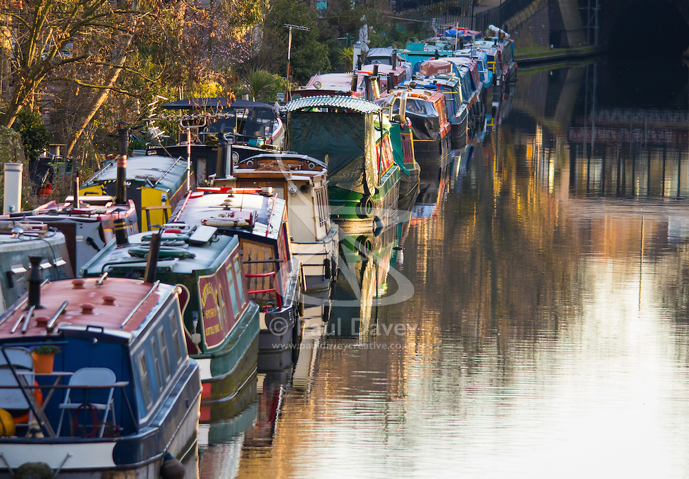 Little Venice, London, February 19th 2016. The first rays of sunshine refect of narrowboats on the Regent's Canal as the sun rises on a clear, cold February morning. ©Paul Davey<br /> FOR LICENCING CONTACT: Paul Davey +44 (0) 7966 016 296 paul@pauldaveycreative.co.uk