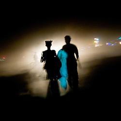 Aug. 29 2008 - Black Rock City, Nevada, USA - A couple walks onto the playa Friday night, Aug. 29, 2008, during the Burning Man arts and culture festival in Black Rock City in the Black Rock Desert near Gerlach, Nev. (Credit Image: © David Calvert/ZUMA Press)