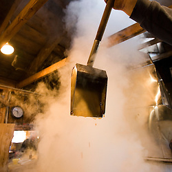 Keith Fifield tends his sap evaporator at the Fifield's Sugarhouse in Strafford, Vermont.