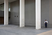 Chef on a break interacts with concrete columns, part of the architecture of the Royal Festival Hall on the Southbank, London, United Kingdom. The South Bank is a significant arts and entertainment district, and home to an endless list of activities for Londoners, visitors and tourists alike. (photo by Mike Kemp/In Pictures via Getty Images)
