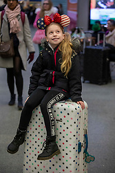 © Licensed to London News Pictures. 20/12/2019. Jasmine Burden 11 from Suffolk waits patiently for her train to Disneyland Paris as the Christmas Getaway starts at St Pancras Station. Heavy rain today is causing chaos for the  thousands who are expected to travel for the festive period: Alex Lentati/LNP