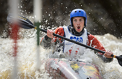 """Hunter Smoak of Ames, Iowa races in the K1 men's Novice/Expert class on the slalom course of the 45th Annual Missouri Whitewater Championships. Smoak placed fifth in the class and first in the downriver K1 Men's Novice class. The Missouri Whitewater Championships, held on the St. Francis River at the Millstream Gardens Conservation Area, is the oldest regional whitewater slalom race in the United States. Heavy rain in the days prior to the competition sent water levels on the St. Francis River to some of the highest heights that the race has ever been run. Only expert classes were run on the flood level race course. Novices who chose to race were re-classified as """"novice experts"""" to recognize their achievements."""