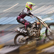 A blur of motion as Johnnie Buller, Suzuki, flies through the air during the Monster Energy AMA Supercross series held at MetLife Stadium. 62,217 fans attended the event held for the first time at MetLife Stadium, New Jersey, USA. 26th April 2014. Photo Tim Clayton