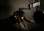 West Memphis, Ark. - Mary Clarksenior, left, of West Memphis, goes through an eye examination with Ophthalmologist Dr. Norman Denton at the East Arkansas Family Health Center in West Memphis, Ark. on Friday March 6, 2019.<br /> <br /> <br /> CREDIT: William DeShazer