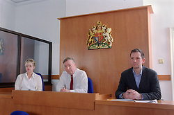 Panel of magistrates listening to case of young offender in youth court,