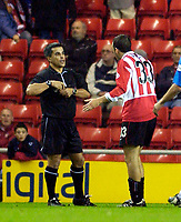 Photo. Jed Wee.<br /> Sunderland v Wigan Athletic, Nationwide League Division One, Stadium of Light, Sunderland. 02/12/03.<br /> Sunderland's Julio Arca (R) tries to protest his innocence to referee A Kaye as he is shown a second yellow card.