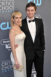 Emma Roberts (L) and Evan Peters at The 23rd Annual Critics' Choice Awards held at the Barker Hangar on January 11, 2018 in Santa Monica, CA, USA (Photo by Sthanlee B. Mirador/Sipa USA)