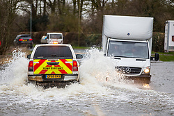 © Licensed to London News Pictures. 28/02/2020. East Cowick UK. Two men became stuck in their vehicle in flood water in East Cowick where residents have ben evacuated from their homes in Yorkshire as the UK prepares for storm Jorge. Photo credit: Andrew McCaren/LNP
