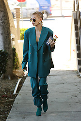 Hailey Baldwin dons a green outfit from head to toe as she heads to a business meeting in Los Angeles. 23 Jan 2019 Pictured: Hailey Baldwin. Photo credit: Rachpoot/MEGA TheMegaAgency.com +1 888 505 6342