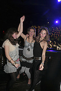 Phoebe Robinson, tessa Sheppard and Arabella Covell , Feathers Ball in aid of the Feathers Clubs. Hammersmith Palais. London. 18 December 2006. ONE TIME USE ONLY - DO NOT ARCHIVE  © Copyright Photograph by Dafydd Jones 248 CLAPHAM PARK RD. LONDON SW90PZ.  Tel 020 7733 0108 www.dafjones.com
