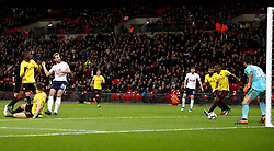 Tottenham Hotspur's Harry Kane (third from left) scores his side's second goal of the game