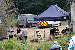 © Licensed to London News Pictures. 11/08/2020. Bisley, UK. Investigators search an area at Priest Lane Farm near Bisley in Surrey as part of an historic murder investigation. Surrey Police, supported by the British Army and specialist forensic teams are carrying out a dig in relation to the murder of Tina Baker, 41, in 2002. Tina was initially reported missing after last being seen in Sunbury on 8 July 2002 but the investigation became a murder enquiry in October 2002. In 2005, following an extensive investigation by the Surrey and Sussex Major Crime Team, Tina's husband, Martin Gerald Baker, was arrested and charged with her murder. In 2006, he was sentenced to 14 years behind bars. Tina's body was never recovered. Following the conviction, enquiries continued by Surrey Police in order to find out what happened to Tina Baker's body. Information received has resulted in the decision to carry out forensic investigations in Bisley. Photo credit: Peter Macdiarmid/LNP