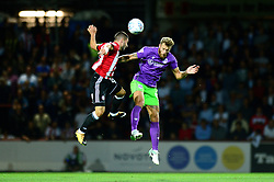 Nathan Baker of Bristol City challenges for a header with Neal Maupay of Brentford - Mandatory by-line: Dougie Allward/JMP - 15/08/2017 - FOOTBALL - Griffin Park - Brentford, England - Brentford v Bristol City - Sky Bet Championship