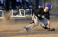 Chester, New York  - A Frozen Ropes baserunner changes direction while caught in a rundown during the TRUMP March Madness youth baseball tournament at The Rock Sports Park on March 17, 2012.